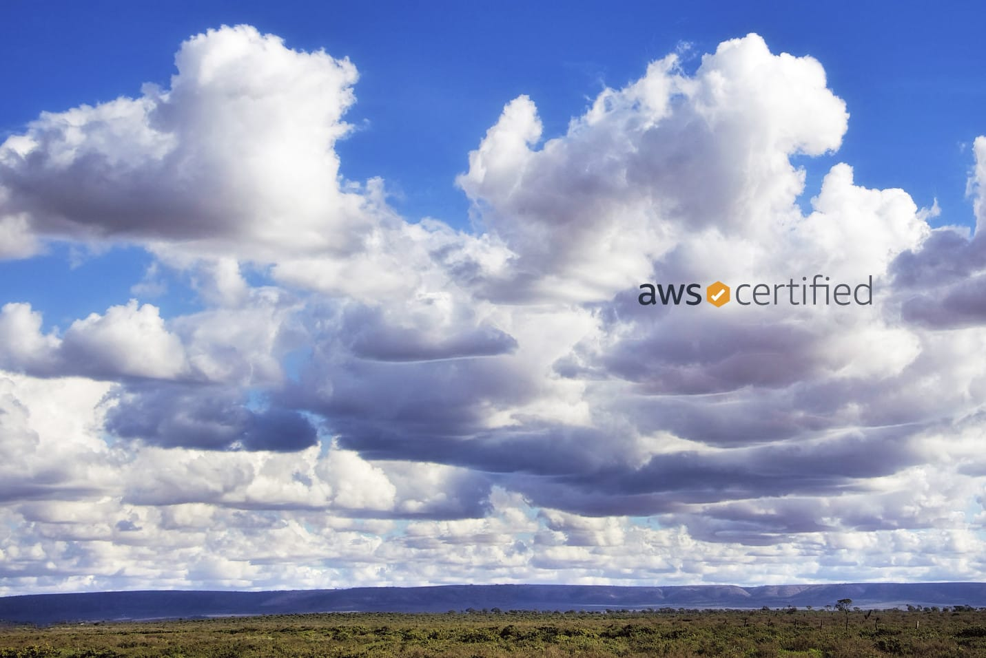 Picture of clouds with AWS Certified logo on top